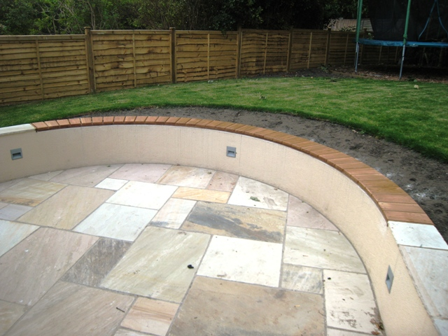 Curved garden wall seat |